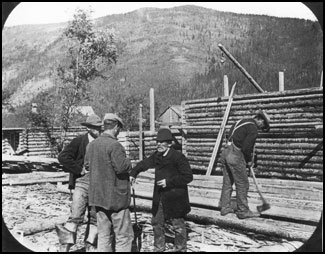 Photo of Buck with laborers building his store.