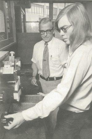 Don Cook with a student.