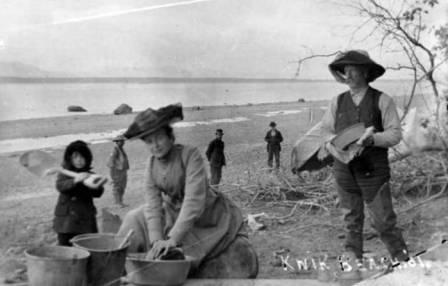 Herning family washing dishes on Knik Beach, circa 1901 - Elmer (with shovel), Mattie, and Orville Herning(?).