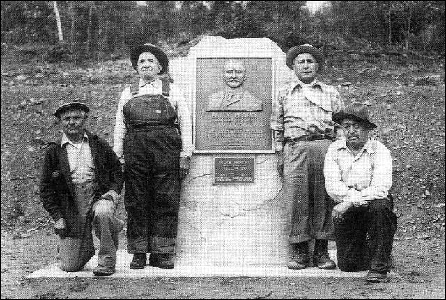 Miners who knew Felix Pedro pose with the Pedro Monument on Steese Highway