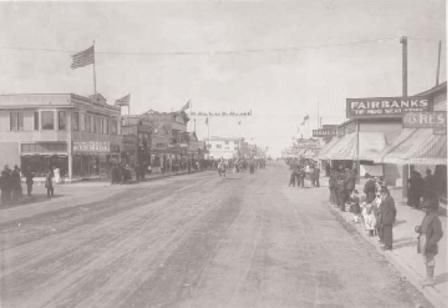 Fourth of July parade in Anchorage, Alaska showing the A. A. Shonbeck General Merchandise store on the left, circa 1918.